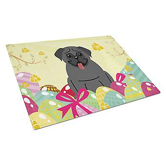 Carolines Treasures  BB6006LCB Easter Eggs Pug Black Glass Cutting Board Large