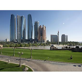 Etihad Towers and other tall buildings on Corniche Road seen from upper driveway entrance to Emirates Palace Hotel Abu Dhabi United Arab Emirates Poster Print