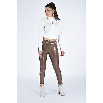 Curst naisten vetoketjullinen kiiltonahka näyttää housut