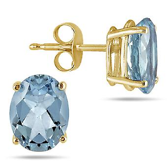 6x4mm Oval Aquamarine Stud Earrings Made in 14K Yellow Gold