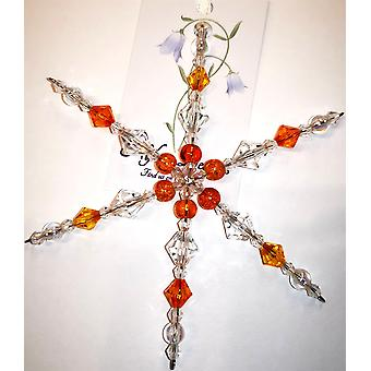 Handmade hanging Snowflake decoration in orange/yellow by Nyleve Designs