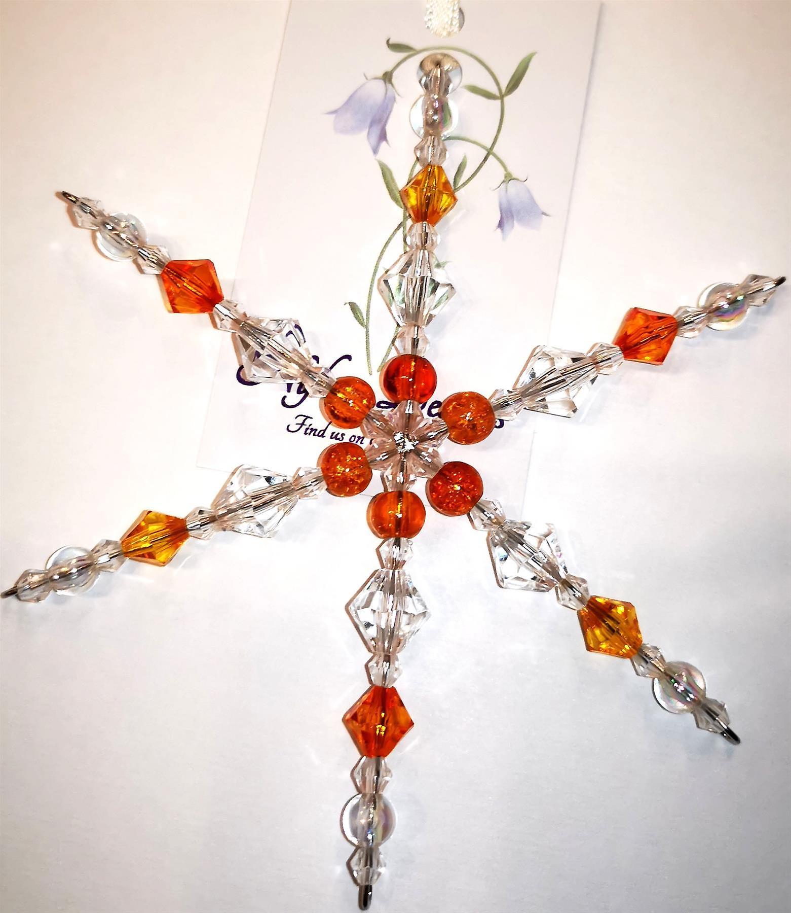 Nyleve Designs handmade hanging Snowflake decoration in orange/yellow