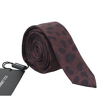 Ruskea silkki musta pilkullinen ohut solmio