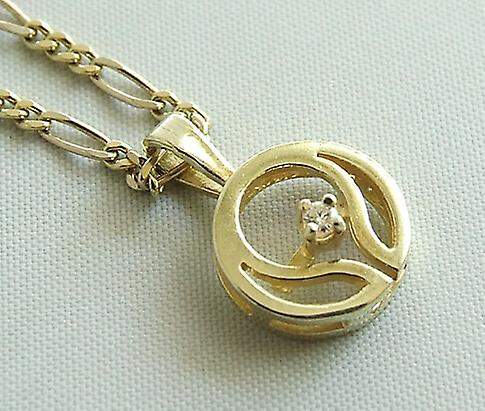 14 Karat yellow gold globe with necklace