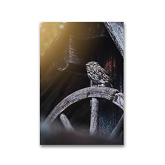 Owl Sitting On A Wooden Wheel Poster -Image by Shutterstock