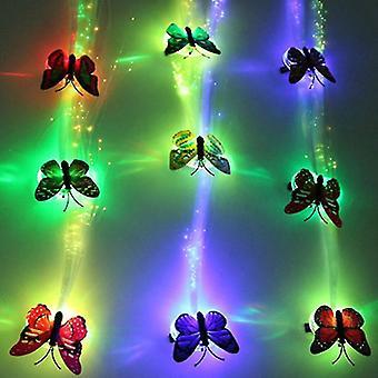 Hiustenpidennys johti värikkääseen perhoskarvapunokseen hehkuvaan hehkuvaan koristeeseen