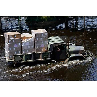 A National Guard M817 5-ton Dump Truck fords the floodwaters Poster Print by Stocktrek Images