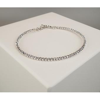 14 carat Christian white gold bracelet