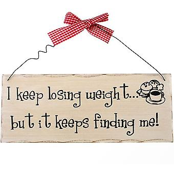 Je continue à perdre du poids Signe suspendu