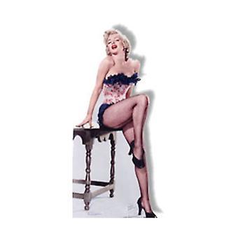 Marilyn Monroe trug Netz Strümpfe sitzen am Tisch Karton Ausschnitt