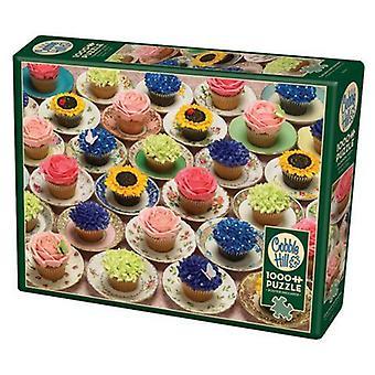 De heuvelpuzzel van de kasseien - cupcakes & schotels