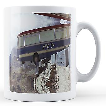 Printed mug featuring Banksy's, 'Bus on Cliff Edge' artwork