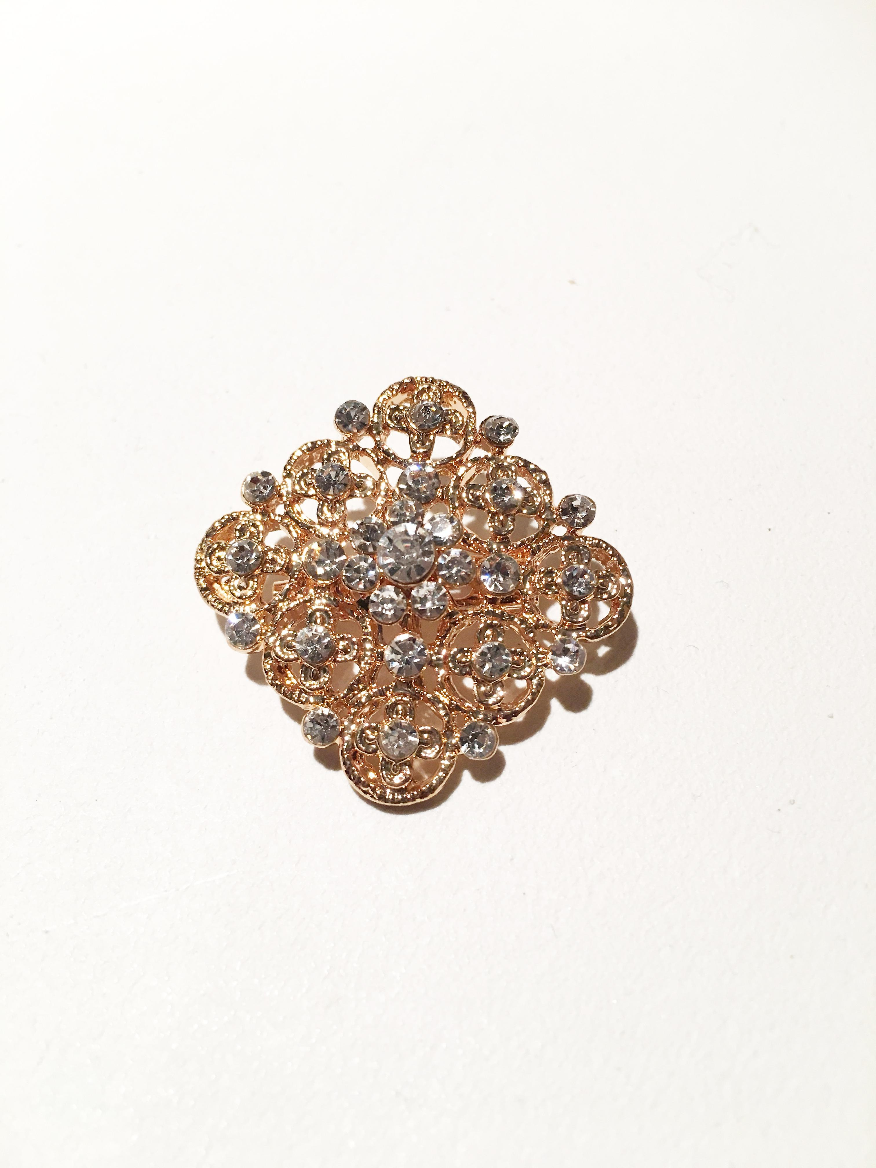 gold and silver rectangle crystal brooch