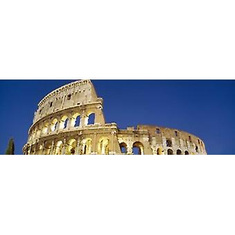 Low angle view of ruins of an amphitheater Coliseum Rome Lazio Italy Poster Print