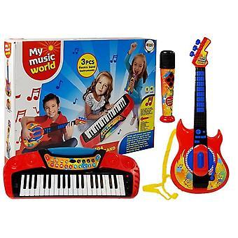 Ensemble de musique avec guitare, clavier et microphone