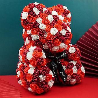 Ours rose mignon de fleurs de mousse - décoration de partie de mariage