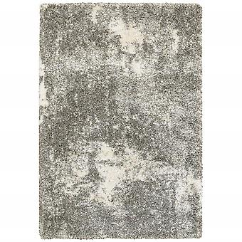 2' x 3' Gray and Ivory Distressed Abstract Scatter Rug