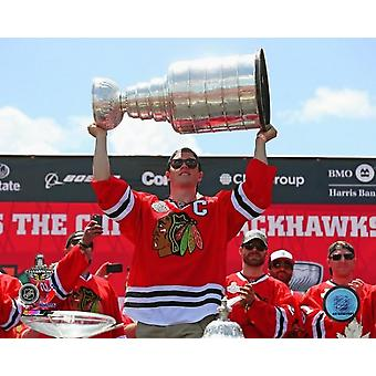 Jonathan Toews with the Stanley Cup during the Blackhawks Victory Parade Photo Print