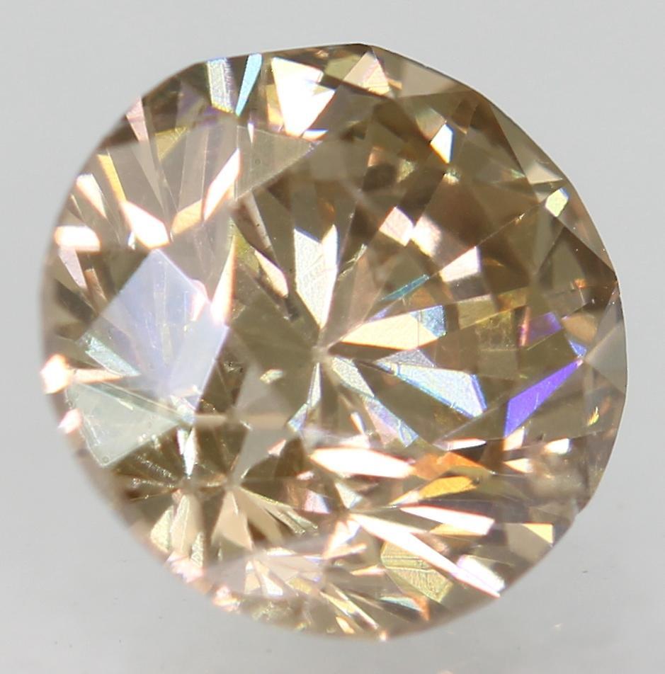 Cert 0.71 Carat Fancy Brown VS1 Round Brilliant Enhanced Natural Diamond 5.52mm