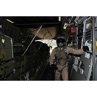 Container Delivery System bundles exit a C-17 Globemaster during an airdrop mission Poster Print