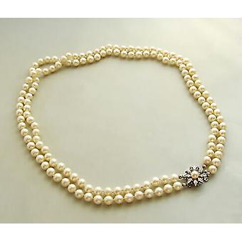 Pearl Necklace with a sapphire and diamonds slot