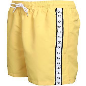 Calvin Klein Premium Logo Tape Athletic-Cut Swim Shorts, Mimosa Yellow
