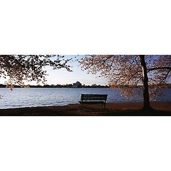 Park bench with a memorial in the background Jefferson Memorial Tidal Basin Potomac River Washington DC USA Poster Print