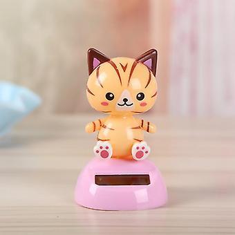 Söpö aurinkovoimalla toimiva tanssivat kissat heiluttavat bobble-lelua