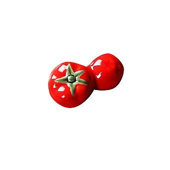 Palillos cerámicos descansan tomate