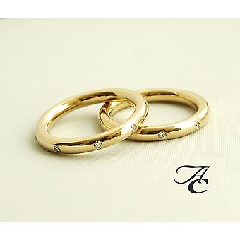 Atelier Christian gold wedding rings with diamond