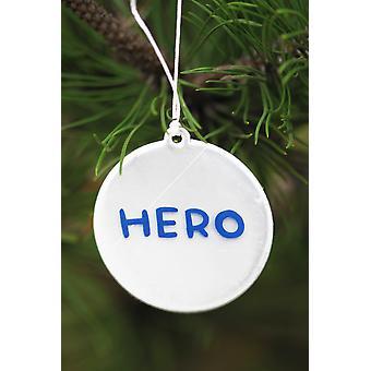 """Refletor com uma escrita """"herói"""""""
