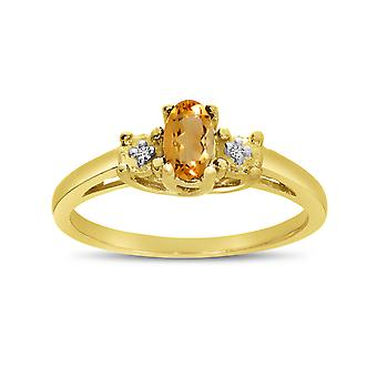 LXR 14k Yellow Gold Oval Citrine and Diamond Ring 0.15 ct