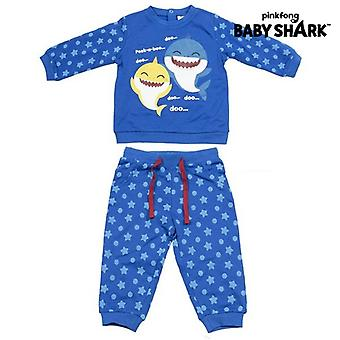 طفل البدلة الرياضية بيبي القرش الأزرق