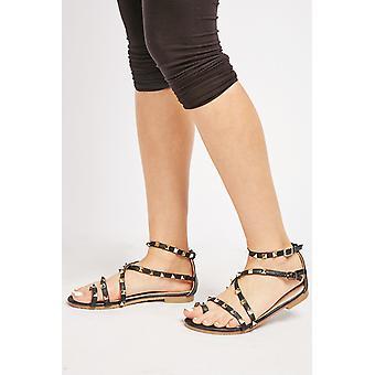 Sandálias de tiras de cruz cravejadas