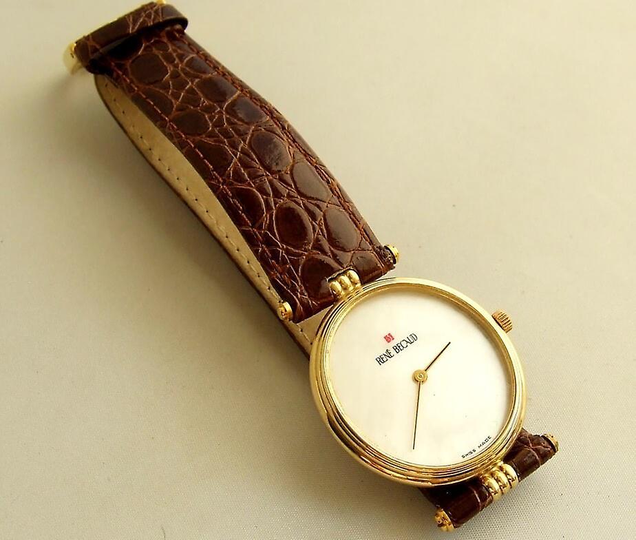Golden Rene Becaud watch