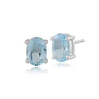 Classic Oval Blue Topaz Stud Earrings in 9ct White Gold 7x5mm 10256