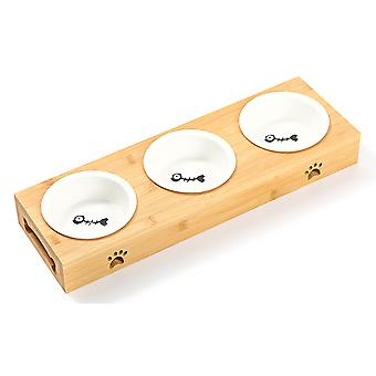 Spezielle Futterschüssel für Hauskatzen und Hunde, Keramikschüssel auf Holztisch