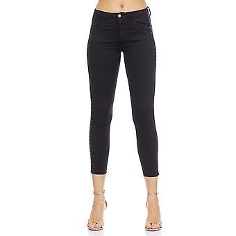 Dünne schwarze Jeans mit silbernen Verzierungen
