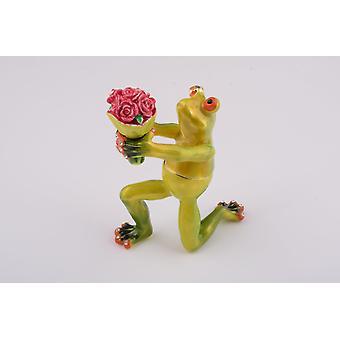 Fleurs romantiques de fixation de grenouille
