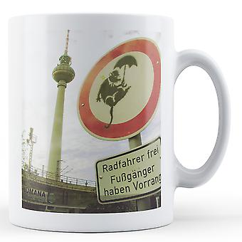 Printed mug featuring Banksy's, 'Rat with Umbrella Falling' artwork