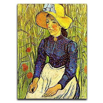 Junge Bäuerin mit Strohhut sitzt in der Weizenleinwand