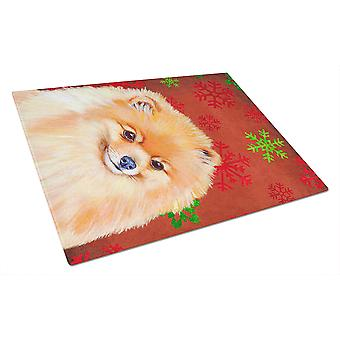 Pomeranian Red and Green Snowflakes Holiday Christmas Glass Cutting Board Large