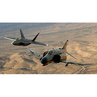 An F-4 Phantom and an F-22A Raptor fly in formation Poster Print by Stocktrek Images