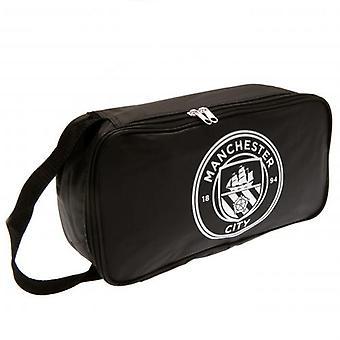 Manchester City FC musta saapas laukku