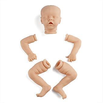 Vastasyntynyt nukkuva kaksonen tahraamaton keskeneräinen nuken osat