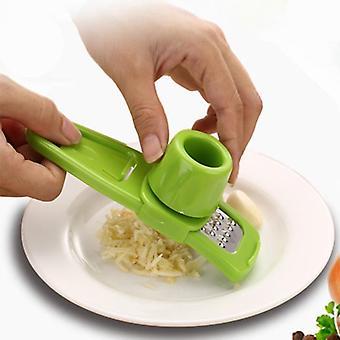 Ruostumaton teräs valkosipulipuristin murskain, keittiö ruoanlaitto vihanneksia inkivääri