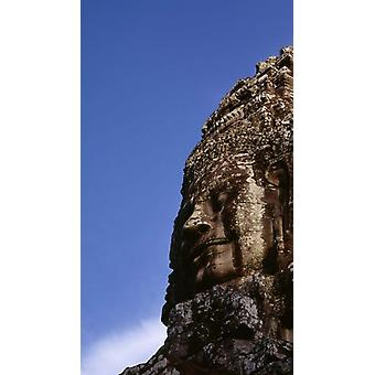 Low angle view of a face carving Angkor Wat Cambodia Poster Print