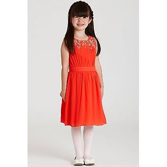 少しオレンジのシフォンの装飾のドレスを MisDress