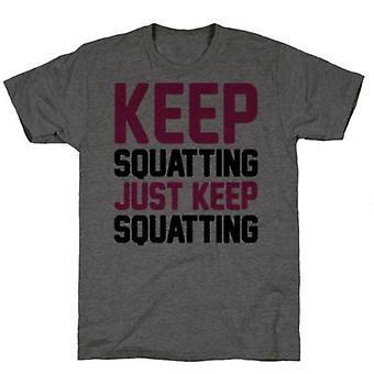 Continuez à squatter juste garder squatter le t-shirt de charbon de bois