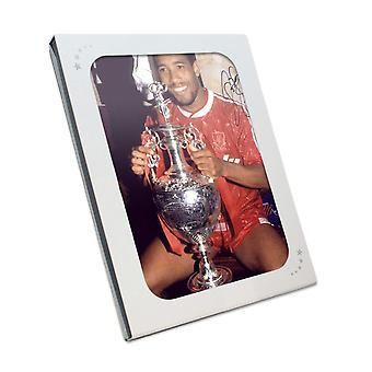 John Barnes Signed Liverpool Photograph: Holding The League Championship. In Gift Box
